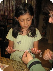 nina giving glass rosary