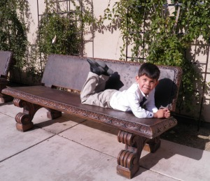 papi on a bench before mass