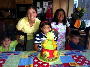 8.25.12 sweetie and siblings with cake