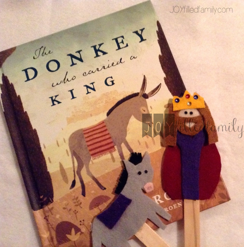 christ the king and donkey with book